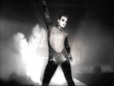 Music video by Robbie Williams performing Let Me Entertain You. (P) 1998 The copyright in this audiovisual recording is owned by Chrysalis Records Ltd.