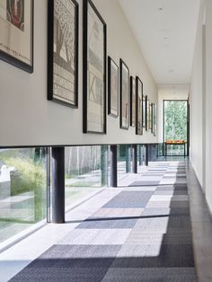 Modern home with Hallway, Rug Floor, and Concrete Floor. An art gallery was designed with low windows to allow natural light to permeate while protecting the sensitive art from harmful direct sunlight. It is these careful details that, in combination with the striking lineation of the home, create a harmonious alliance of function and design. Photo 4 of Wyoming Residence