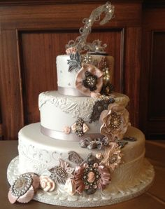 EDITOR'S CHOICE(11/19/2013) Vintage Broach Wedding Cake by Over The Top Cakes Designer Bakeshop  View details here: http://cakesdecor.com/cakes/98074