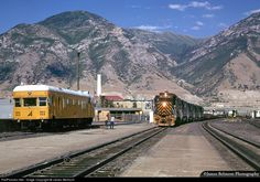 Sperry Rail Service employees give their track detector car a good bath while a Rio Grande manifest makes a pickup at Provo Yard.