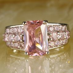 'Stunning Emerald Cut Pink Topaz Gemstone Ring Size 9' is going up for auction at  4pm Wed, Jul 10 with a starting bid of $6.