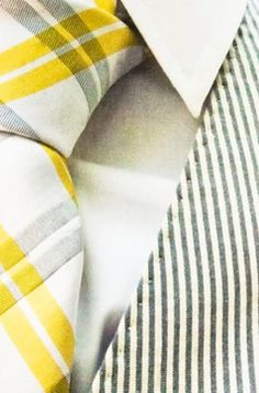 Yellow Tie, looks nice w/ a long sleeve(Man) white shirt, jeans,(skinny),  light gray boots(over-the-knee), & a cute Mustard bag.  =D