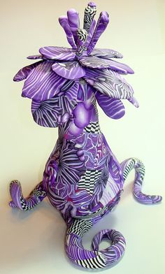 Stop & Smell the Flowers - Purple Polymer Clay Sculpture by by Artisan Sherri Kellberg.