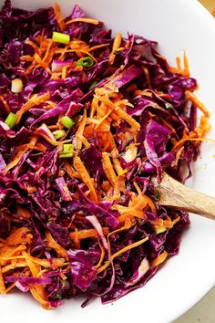 Red Cabbage and Carrot Slaw Recipe - Tossed with an incredible Apple Cider Vinaigrette, this tangy slaw is light, crunchy, refreshing, and serves perfectly as a side dish or even an appetizer.