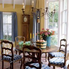 yellow French country dining-Suzy Stout designer  Love the yellow and blue checks and the light fixture is something I would love to find.