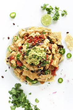 The Best Damn Vegan Nachos with Cashew-less Vegan Queso! Seriously the best ever! You'd never guess they were dairy-free. #vegan #glutenfree