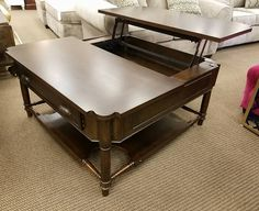We have this beautiful dark expresso lift top cocktail table.