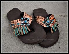 Summertime flips flops in coral croc hide, fringe of taupe and turquoise, antique copper conchos with turquoise/topaz.