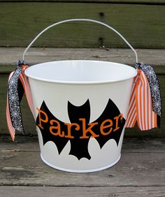 Personalized Halloween buckets-many designs available. $22.00, via Etsy.