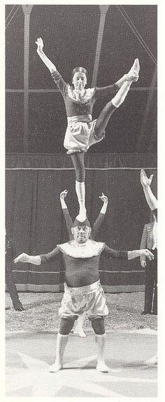 Circus acrobats i love the baggy shiny shorts.