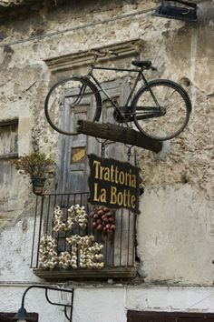 Bicycle used above a travern sign in Tropea, province of Vibo Valentia, Calabria region Italy Calabria Italy, Tropea Italy, Sardinia Italy, Purple Home, Shop Fronts, Store Signs, Belle Photo, Italy Travel, Shopping Travel