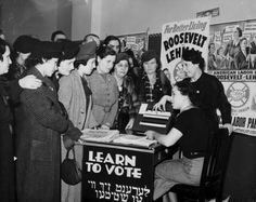 Jewish immigrant women learning how to Vote in the USA in 1935 (see the Yiddish translation on the sign).