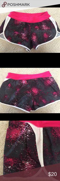 "Nike athletic shorts (women's medium) Pink, grey, and white Nike ""Dri-Fit"" athletic shorts with pink lining. Rarely worn. Nike Shorts"