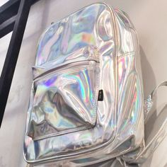 Holographic Backpack Silver Hologram Rucksack Travel School Bag by pingypearshop on Etsy https://www.etsy.com/listing/215252222/holographic-backpack-silver-hologram