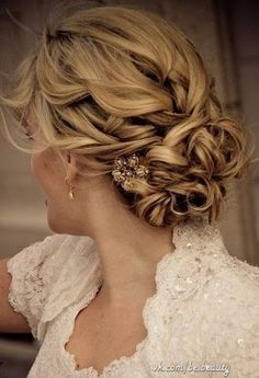 Goldish brooch with collected curly hair and lace dress for wedding #hot #sexy #hairstyles #hairstyle #hair #long #short #medium #buns #bun #updo #braids #bang #greek #braided #blond #asian #wedding #style #modern #haircut #bridal #mullet #funky #curly #formal #sedu #bride #beach #celebrity #simple #black #trend #bob #girls