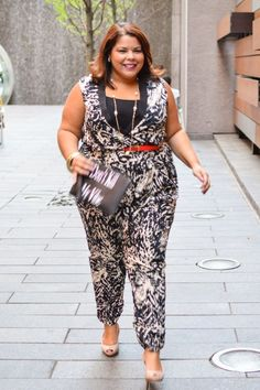 Blogger Darlene from Suits Heels and curves in FTF'S Safari Animal Print Jumpsuit