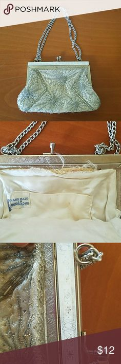 Beaded handbag Sweet little handbag. Shows some wear.as pictured, but I didn't notice it until I started looking. I love this bag, used it for my wedding.  Bottom measures 7 in wide. 5in from clasp to bottom. Chain measures 7 in to clasp. Bags Clutches & Wristlets