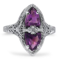 The Idris Ring From Brilliant Earth - Two ravishing trillion shaped Amethysts mirror each other in this decadent ring from the Edwardian era, which features gorgeous filigree and a shamrock detail at the center (Amethysts approx. Purple Jewelry, White Gold Jewelry, Amethyst Jewelry, I Love Jewelry, White Gold Rings, Jewelry Accessories, Fine Jewelry, Antique Jewelry, Vintage Jewelry