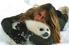 Brigitte Bardot, actress and animal rights activist poses with harp seal pup. For info on Canadian sealhunt, see our website www.thesealsofnam.org/canadian-hunt/