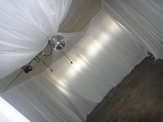 My garage transformed by plastic draping with help from a friend, turn any room beautiful