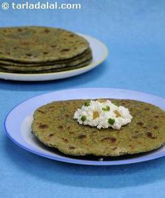 Puréed green peas are combined with whole wheat flour to make this delicious paratha dough. You can even make plain green pea parathas using this dough.   The paneer used for this recipe should be fresh and preferably home-made. Enjoy these parathas with Punjabi aam ka achaar.