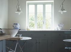 Pretty painted cupboards and fisherman's lamps