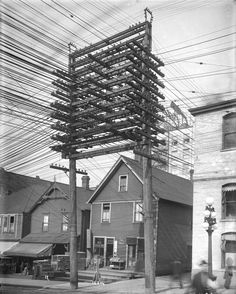 Photos from the Days When Thousands of Cables Crowded the Skies. Power lines and supporting structure in a lane west of Main Street in Vancouver, British Columbia, March 1914 Les Gobelins, Haute Tension, Cable, Glass Insulators, Nikola Tesla, Foto Art, Main Street, Historical Photos, British Columbia
