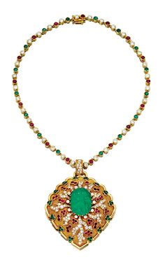 EMERALD, RUBY AND DIAMOND BROOCH/PENDANT, CARTIER 1970S AND A NECKLACE.  The brooch/pendant centring on a cabochon emerald carved with a foliate motif, set within stylised branches of brilliant- and single-cut diamonds, embellished with circular-cut rubies and emeralds, mounted in yellow gold, signed Cartier Paris, French assay and maker's marks; the necklace designed as a line of collet-set brilliant-cut diamonds, circular-cut emeralds and rubies,
