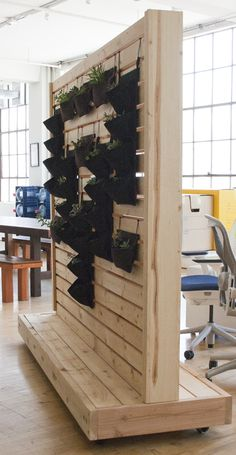 This wall partition is a fun and useful way to separate space in offices with an open layout. Heavy duty locking casters allow the structure to be moved and set in place with ease. The piece is mad… Patio Privacy Screen, Privacy Walls, Murs Mobiles, Sala Vip, Wood Partition, Movable Walls, Diy Room Divider, Temporary Wall, Open Layout