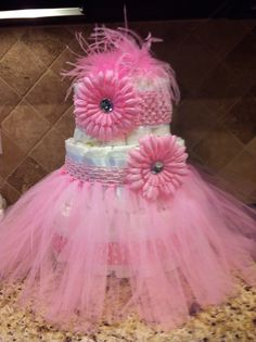 Diaper cake. tutu onto the headband @Maggie Mundle you need to come fix the sewing machine so I can try this!!