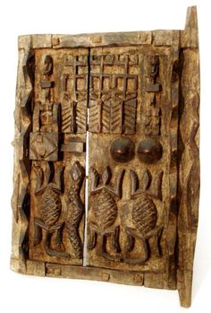 Dogon door Country of Origin: Mali, Africa Approximate Age: Mid 20th century Measurement: 52x 36x 3x (cm) Materials: Wood Weight: 0,5kg Overall Condition: Excellent Damage, Repair: None  Dogon doors are made by the Dogon people from Mali. They are carved out of wood and serve to protect the people's storage buildings or granaries. They almost all have a simple sliding door lock. But the fine sculptures on the door make the door holy and impregnable for intruders t…
