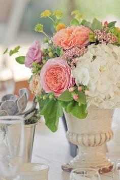 Hydrangea, peonies, hypericum and bupleurum. Love flower arrangements in urns.  French Country.