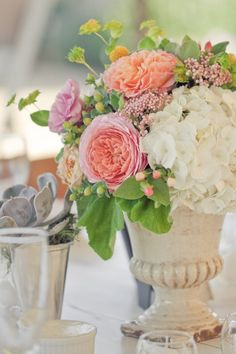 Hydrangea, peonies, hypericum and bupleurum. Love flower arrangements in urns.  French Country.