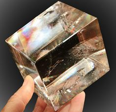 Iceland spar, formerly known as Iceland crystal is a transparent variety of calcite, or crystallized calcium carbonate, originally brought from Iceland, and used in demonstrating the polarization of light.