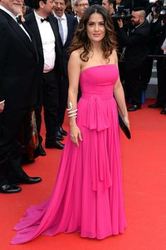 Salma Hayek wore a Saint Laurent gown with Boucheron jewels and a Saint Laurent black studded clutch.