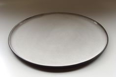 Diana Ferreira Ceramics. Dinner plate. Black clay body, milky white glaze inside.