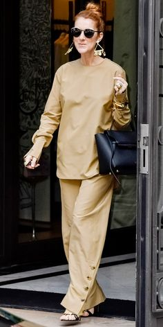 A Look at Celine Dion's Fabulous Fashion Transformation - IN KHAKI SEPARATES from InStyle.com