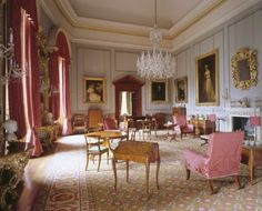 The Drawing Room at Ickworth House in Bury St. Edmunds, Suffolk, England. Showcasing Hervey portraits, rosewood armchairs, wilton carpet & table with floral marquetry