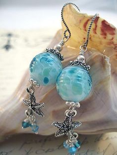 I love the ocean and all of the wonderful sea creatures and shells on the beach!  These gorgeous artisan glass lampwork beads have all the wonderful hues of the ocean in them.  Of course I had to add a few pretty starfish, and my Swarovski crystal dangles.  http://www.artfire.com/ext/shop/studio/StringBeadStudio