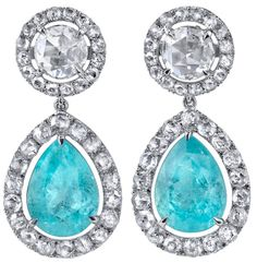 Rare Paraiba Tourmaline and Rose Cut Diamond earrings. USA, 21st Century.      A pair of rare, pear shaped, Paraiba Tourmalines, weighing a total of 4.39 carats, suspended from a round pair of 0.85ct total rose cut diamonds and surrounded by a total of 1.32ct rose cut diamonds. All hand crafted in platinum. Via 1stdibs.