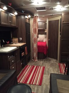 We added a rod and hung a panel to separate the sleeping area from the rest of the little trailer with our new fabric!