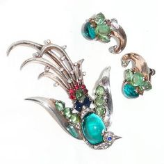 Trifari Lyre Bird paradise fur clip and earrings, designed by Alfred Phillippe. This was done in several colors.