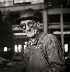 """Goggle Glass: 1942. """"Chicago, Illinois. Workman grinding out a small part at the Chicago & North Western repair shops."""" Medium-format negative by Jack Delano for the Office of War Information."""