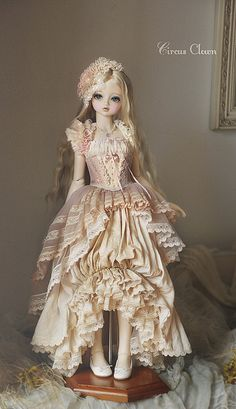 A beautiful ceramic doll. For me, I would love to make it from modeling chocolate as a cake centerpiece!