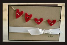Simple, but cute.  Could use paper hearts or felt hearts as well.  Or any kind of shaped button.