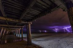 Taken under the jetty at Henley beach as the lightning strikes off in the distance to the North West
