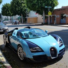 The Bugatti was unveiled in Paris in 1991 and went into production until Bugatti went out of business in 1995 (Bugatti has since been resurrected by Volkswagen). The car was available as a two-door sports car and only 31 cars were produced. Cool Sports Cars, Sport Cars, Cool Cars, Bugatti Veyron Chiron, Bugatti Cars, Car In The World, Dark Blue, Light Blue, Dream Cars