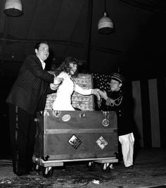 Soldiers cheered when Rita Hayworth, film star, was found again in a trunk, after Orson Welles, director-magician, had tied her in ropes and caused her to vanish on August 9, 1943 in Hollywood. ( AP photo )