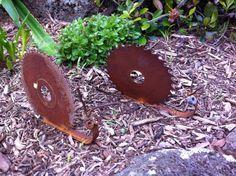 adorable metal welded snails