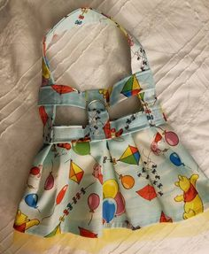 Cotton fabric harnesses dress with tulle tutu and secured with velcro. May choose yellow l, orange, pink or white tulle.